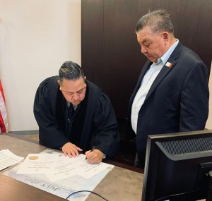 Judge Urbina signing Oath Picture